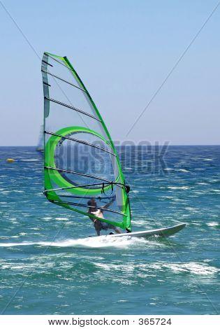 Windsurfer On Sunny Tarifa Beach In Southern Spain