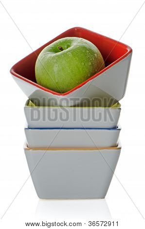 Colorful Bowls With Green Apple