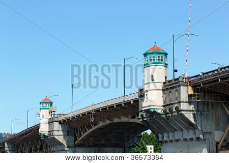 Close up image of Burnside Bridge in Portland, Oregon with cloudless blue sky