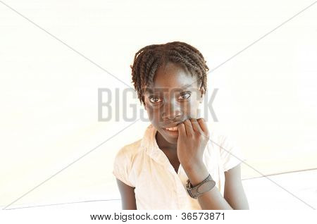 Haitian Kid biting her nails.