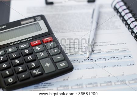 Paperwork price, pen, and calculator.