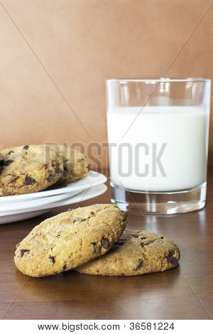 Oatmeal cookies with chocolate and a glass of milk