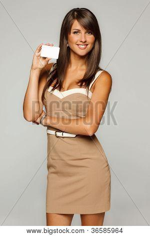 Smiling businesswoman holding empty credit card