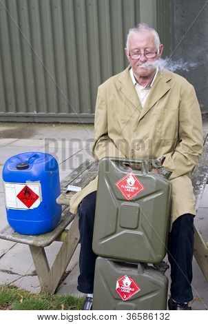 Man smoking near petrol cans