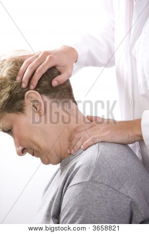 Physical Therapist Examines The Neck