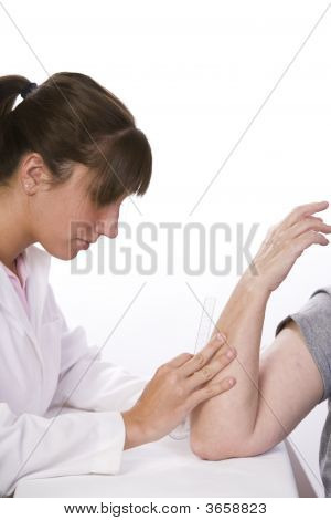 Physical Therapist Measures The Range Of Motion In An Elbow
