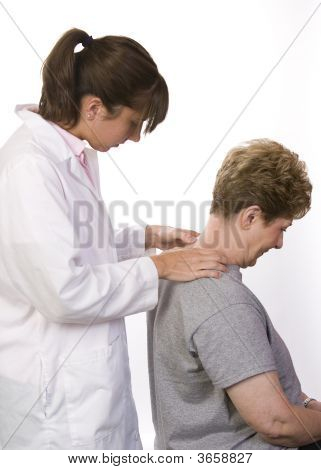 Physical Therapist Checks A Patient's Spine