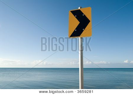 Yellow Traffic Sign At Sea