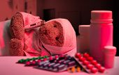 image of infirmary  - Ill teddy bear sleeping in hospital bed - JPG
