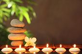 stock photo of candle flame  - Stack of zen stones and aromatic candles on table - JPG
