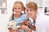 stock photo of pediatric  - Little girl at the doctor - JPG