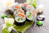 Yin Yang Maki Sushi - Roll made of Fresh Salmon and Cucumber inside. Nori Outside