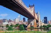 Queensboro Bridge in Midtown Manhattan with New York City skyline over East River as the famous land