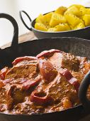 stock photo of british bombay  - Chicken Tikka Masala with Bombay Aloo - JPG