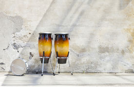image of congas  - two congas in front of a vintage wall - JPG