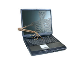 pic of wraith  - An image of a skeleton inside a computer trying to reach out of the screen and take over the computer emblamatic of a computer virus or hacker attack - JPG