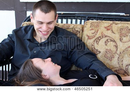 Happy,smiling couple on loveseat