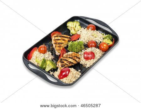 Healthy low fat roast chicken with rice and vegetables.