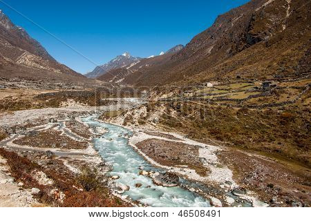 Village And Drained River In Himalaya
