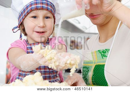 Little Baker Cooking In Kitchen With Mother