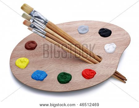 Artist's palette with brushes and oil paints isolated on white background