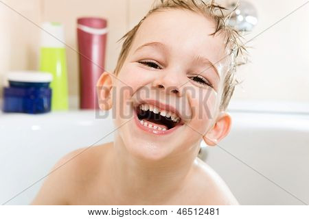 Happy Little Boy Bathing In Bathtub