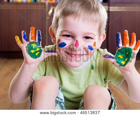 Happy Boy With Colorful  Painted Hands