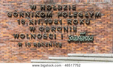 The inscription commemorating the miners