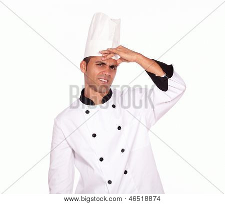 Tired Young Male Cook Standing With Headache