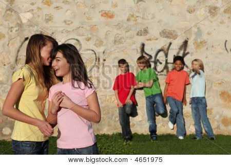 Group Of Kids Flirting And Whispering