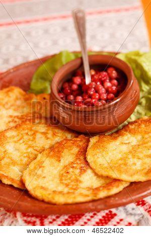 potato pancakes with cranberry sauce