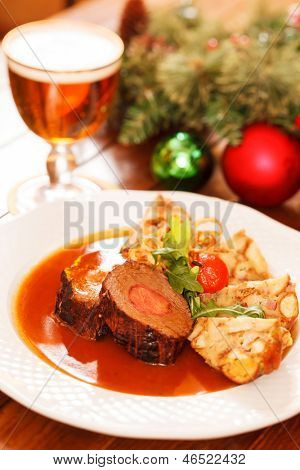 roasted meat on Christmas table