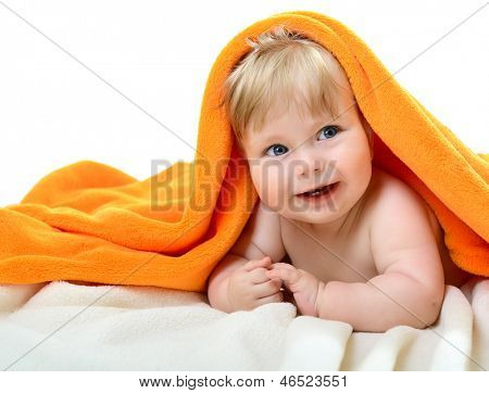 Portrait of cute adorable smiling baby boy look out from orange plaid