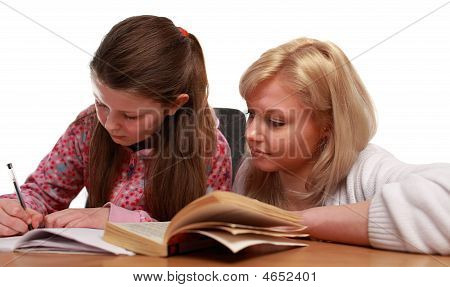 Mother Helping Child With School Work