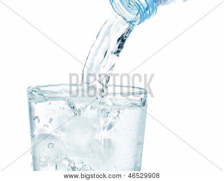 In A Glass With Ice Flowing Clean Water. On A White Background.
