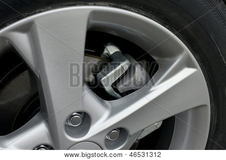 Wheel closeup with brake disc and caliper