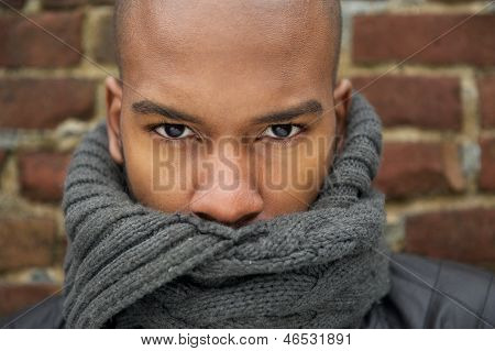 Portrait Of A Black Male Fashion Model With Gray Scarf Covering Face