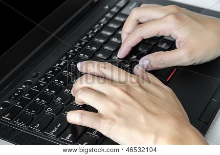 Man's Hands Typing On The Laptop Keyboard