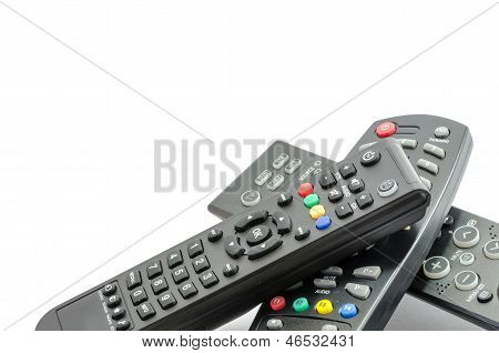 Three Tv Remote Controls Over White Background