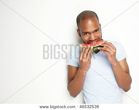 Young Black Man Eating Watermelon Against White Background