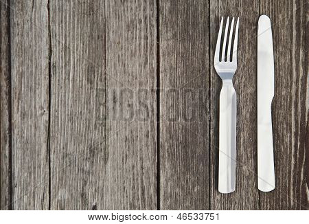 Knife and fork  on old wooden table
