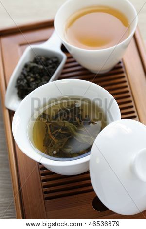 traditional chinese tea ceremony,oolong tea, gaiwan, tasting cup, bamboo tea tray