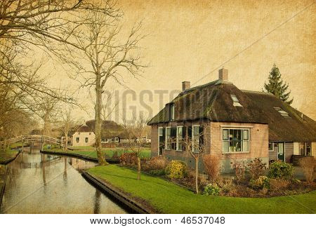 Canal in Giethoorn,  Netherlands. Photo in retro style. Paper texture.