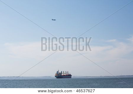 Industrial Ship Under Small Plane