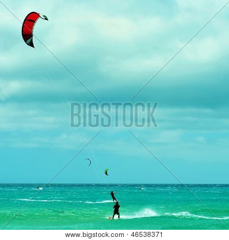 kitesurfers and windsurfers in Sotavento Beach in Fuerteventura, Canary Islands, Spain