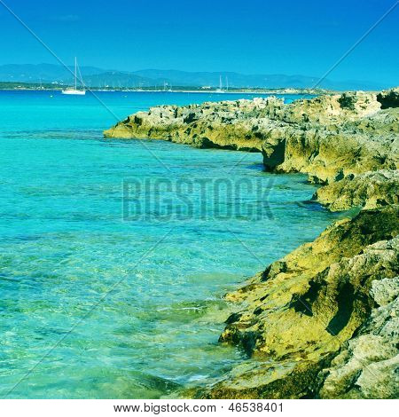 picture of Ses Illetes coast in Formentera, Balearic Islands, Spain, with a retro effect