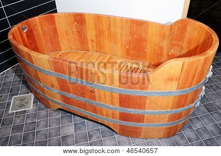 Empty Wooden Bathtube In Modern Bathroom
