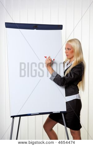 Business Woman On A Flip Chart