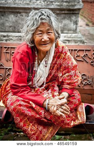 KATHMANDU, NEPAL - MAY 18 - Old woman sit in the retirement home founded by Mother Teresa in Rajrajeshwari Temple near Pashupatinath Temple, Kathmandu, Nepal on May 18, 2013