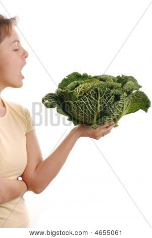 Woman Wanting To Eat Savoy Cabbage - Isolated